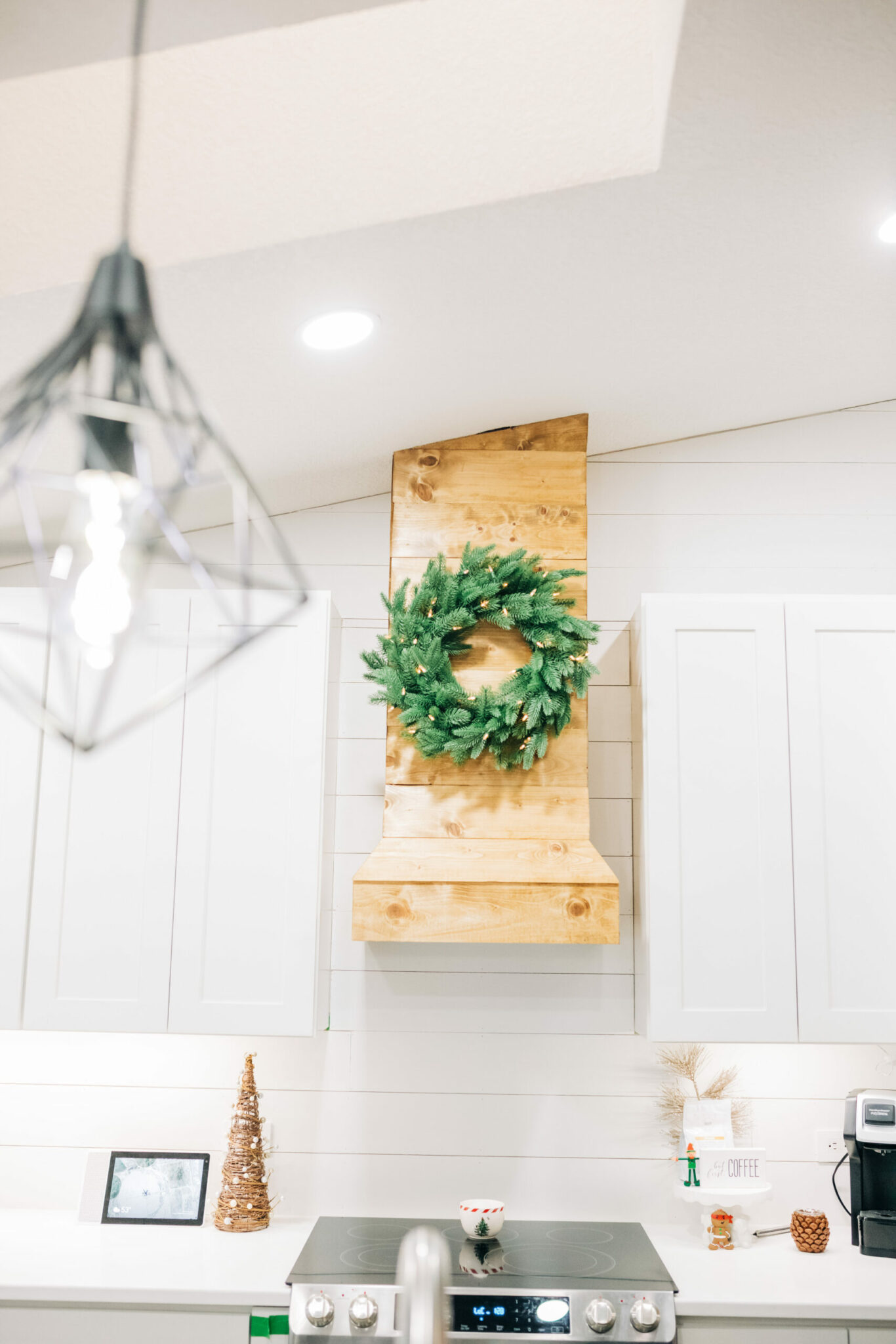 Farmhouse Kitchen Modern Christmas Decor Kitchen, Prelit wreath from Treetopia hung with 3M hooks on hood exhaust