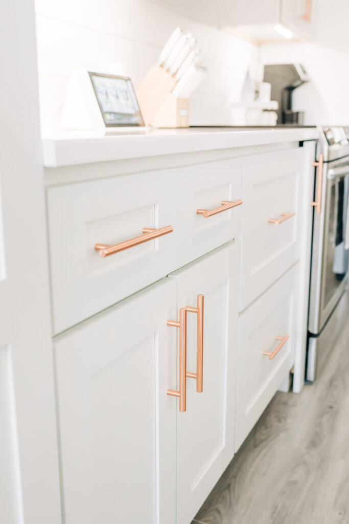 Modern Farmhouse Kitchen Reveal with Sherwin Williams Naval island and American Standard apron front sink, pull down faucet with selectronic technology and stainless steel Samsung kitchen appliances, bowling lane countertop, copper drawer handles