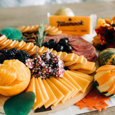 meat and cheese board, holiday charcuterie, family favorite snack board with seasonal fruits, cheese and meats