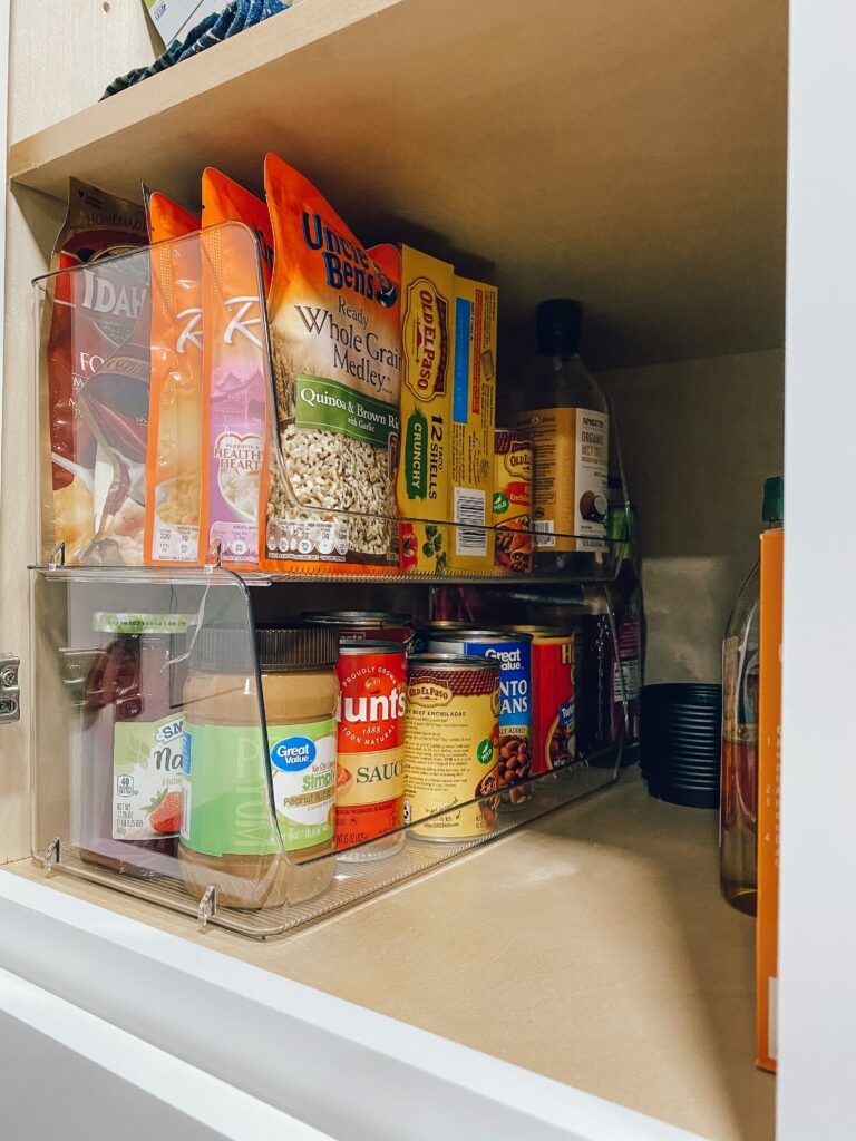 how to organize your narrow pantry with clear stackable bins