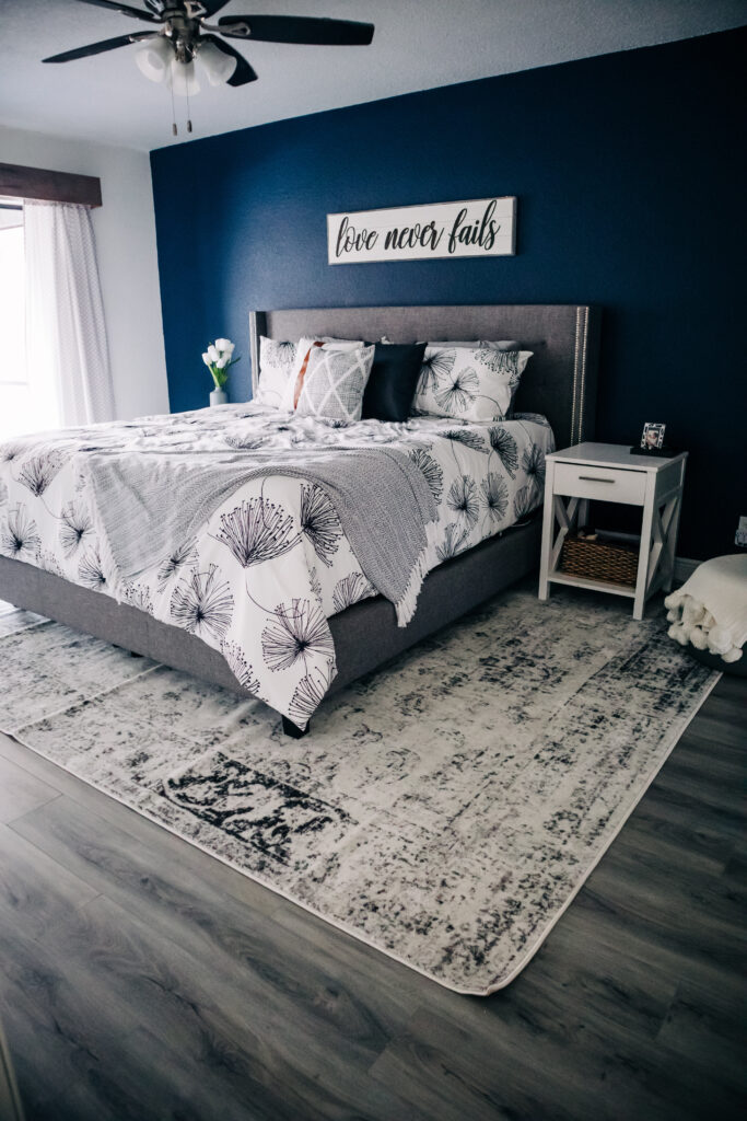 master bedroom refresh, SW Naval, modern comforter set from Home Depot home decor, Love Never Fails sign from Hobby Lobby, Woven Nook inspired throw pillow covers