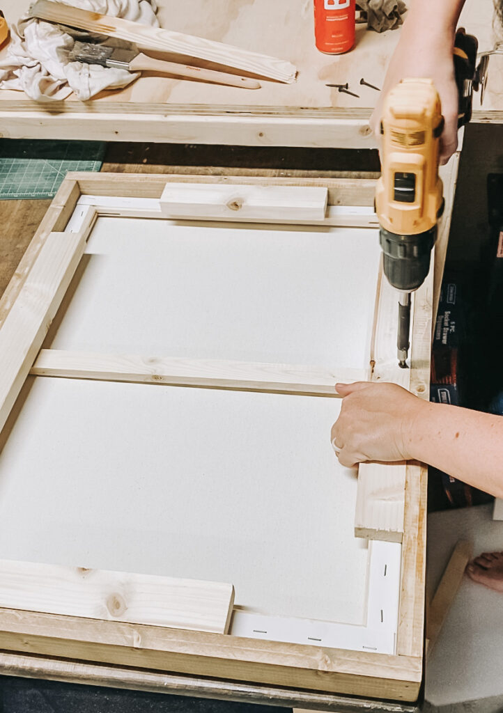 diy wood frame, canvas art frame, wood frame under $10, how to frame your art canvas for cheap
