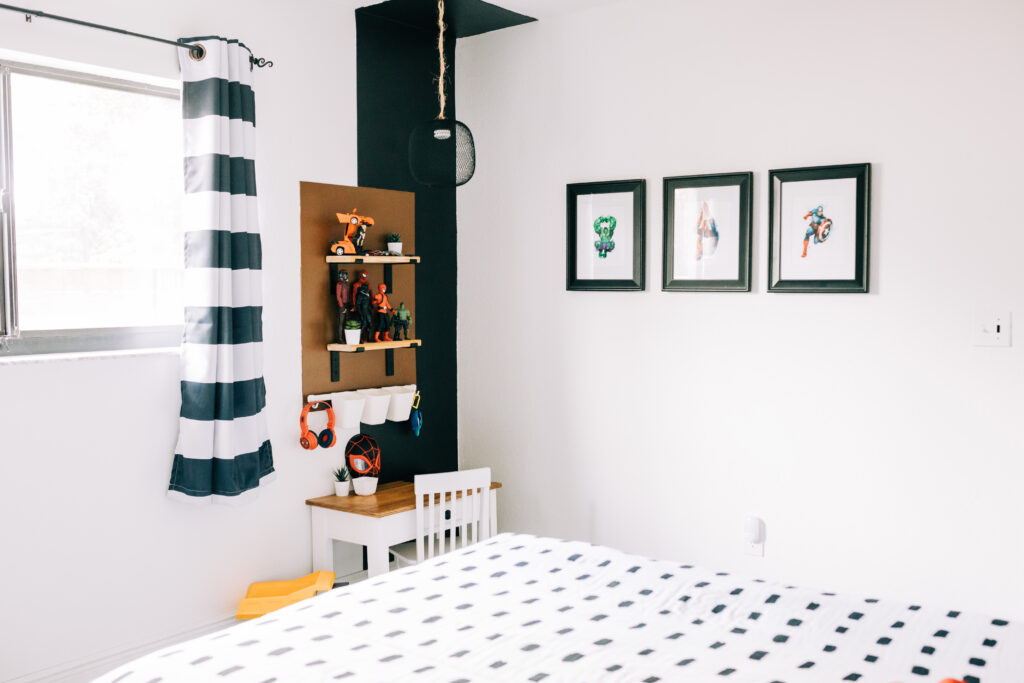 #boysbedroom #superherobedroom #modernsuperhero #colorblock A modern boho color block wall in our son's superhero themed bedroom includes floating wall shelves, a puck light hack within a pendent light and other fun elements.