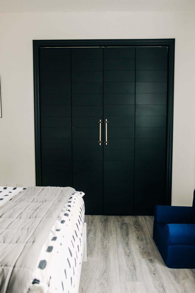 black shiplap bifold door update with wood dowel handles