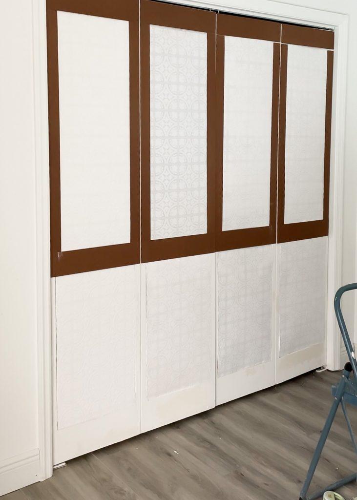updating bifold closet doors with hardboard trim and wallpaper
