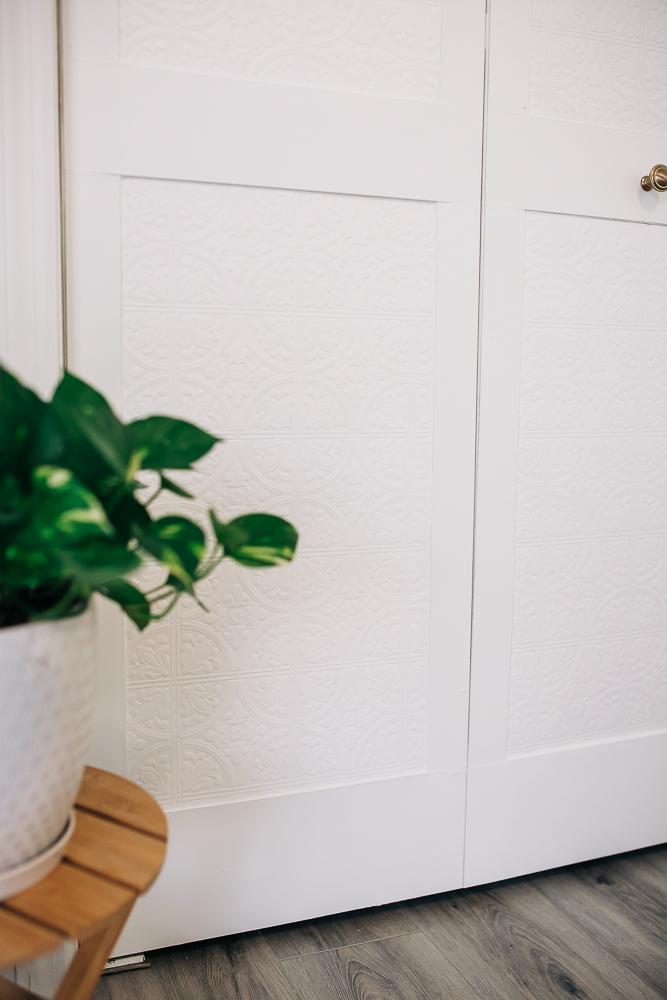 bifold door update with hardboard and wallpaper